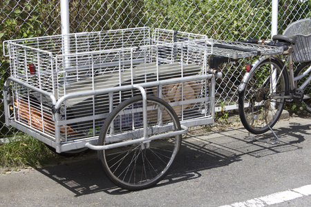 towed: Carts to be towed by bicycle Stock Photo