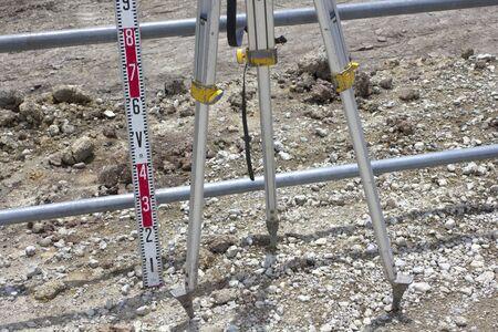 surveying: Surveying tripod of civil engineering construction site
