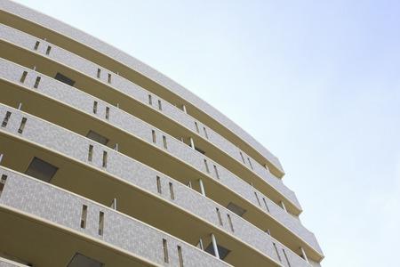 verandah: Exterior wall of the apartment building and blue sky