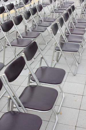 venue: A lot of folding chair which is arranged in the event venue