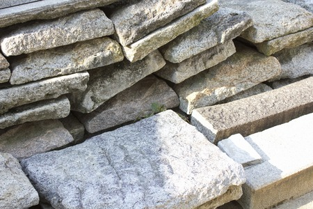 road shoulder: Paving stones that were stacked in the shoulder