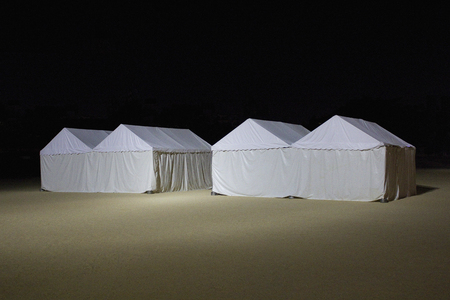 erected: White tent that was erected on the night of park