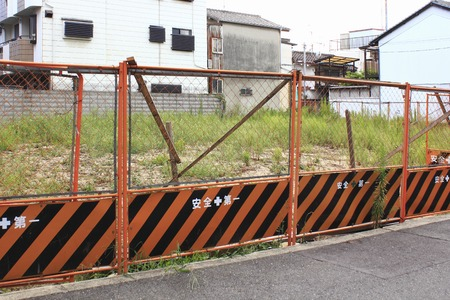 vacant lot: Vacant lot of a residential area that was surrounded by the safety fence