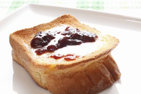 thick: Thick slice toast topped with jam and butter