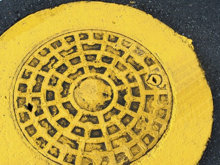 manhole cover: Yellow painted manhole cover