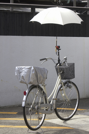 parasol: Parasol attached to the bicycle handle