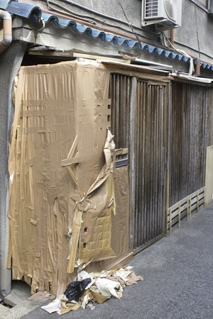 packing tape: Walls of houses that have been repaired with packing tape