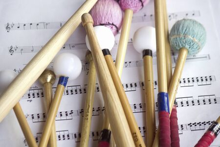 Percussion of the stick and score