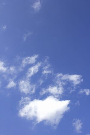 gaping: gaping floating white clouds in the crystal clear autumn sky Stock Photo