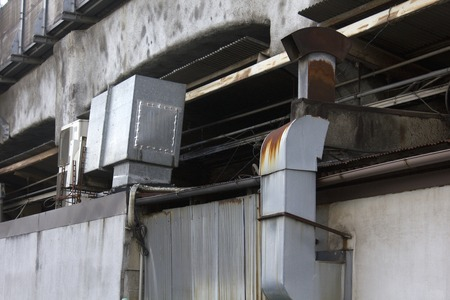 exhaust: Exhaust duct contaminated with eateries of oil Stock Photo