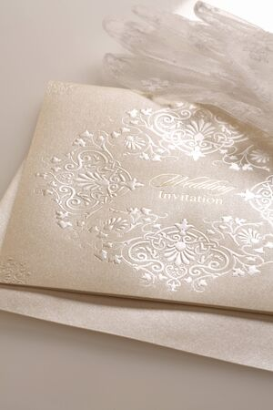 white gloves: Lace wedding invitations with brides white gloves