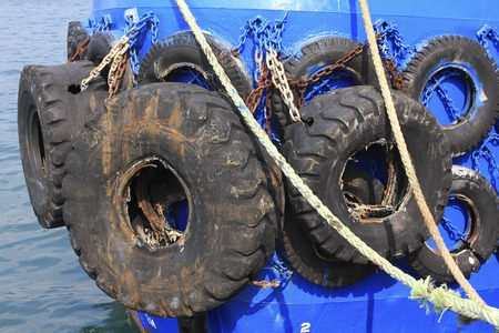 absorption: Old tires for shock absorption of fishing boat