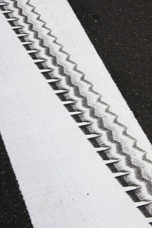 tire marks: Tire marks of the white line of the crosswalk