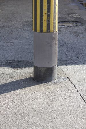 utility pole: Utility pole which is built in the center of the road