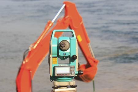 surveying: Surveying instrument of coastal construction Stock Photo