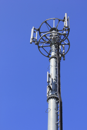 transmitting: Of mobile phone transmitting and receiving antenna and blue sky