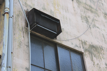 Installed on the outer wall of the building was old air conditioning of the outdoor unit