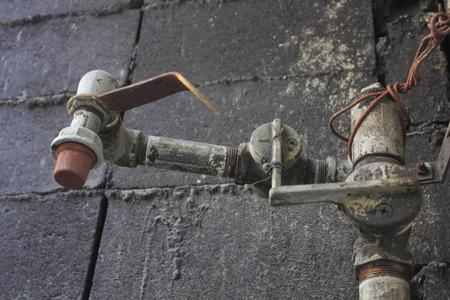 都市ガスの汚れたプラグの開閉