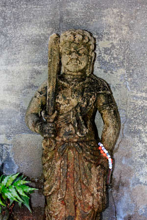 immobility: Stone statue of Acala Stock Photo