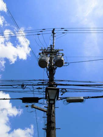 utility pole: Silhouette and blue sky of a utility pole