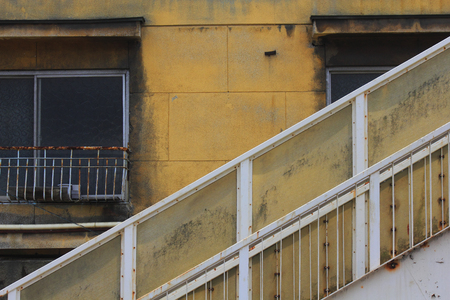 discolored: Apartment of discolored walls and overpass stairs