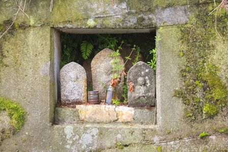 embed: Jizo which is embedded in the wall of the concrete