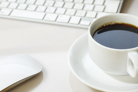 computerize: PC keyboard and hot coffee