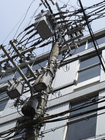 street corner: Electrical wire that was dense and utility poles of street corner Stock Photo