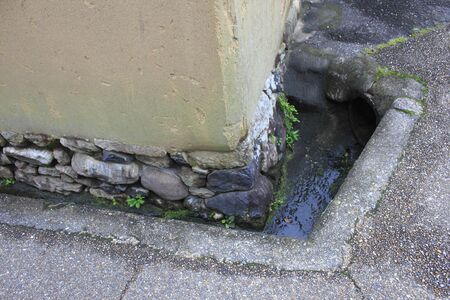 drainage: Drainage groove of house Stock Photo