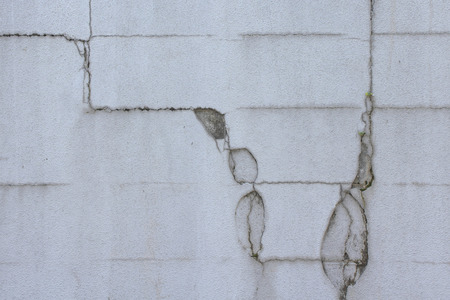 crazing: Wall of cracked concrete block