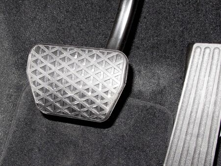 passenger car: Accelerator pedal and the brake pedal of the passenger car