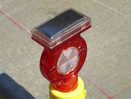 The red light by the solar power of the road construction site