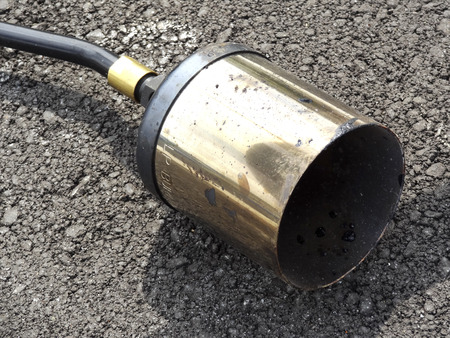 orifice: Injection port of the gas burner for road construction Stock Photo