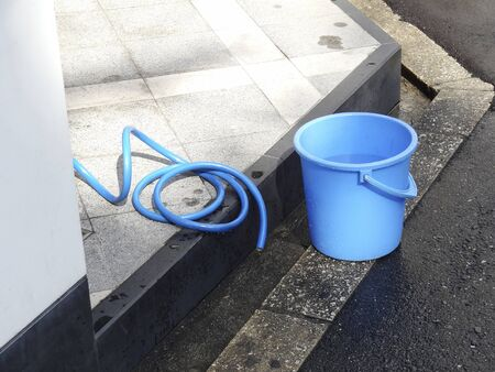 hoses: Buckets and water hoses to clean