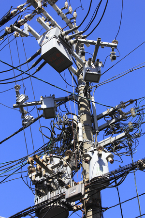 telephone pole: The dense wire and telephone pole