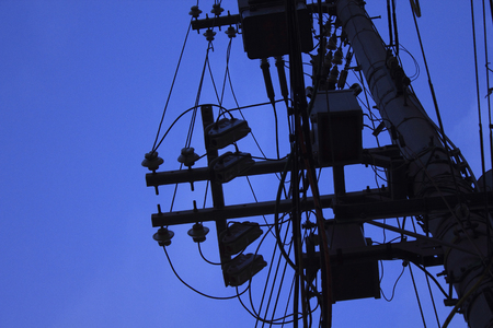 utility pole: dense wire and utility pole silhouette