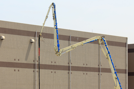 concrete pump: Concrete pump trucks of construction site of building Stock Photo