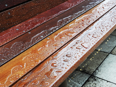 be wet: Wooden bench that was wet with rain Stock Photo