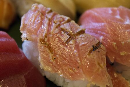 broiled: Broiled grip of Toro sushi Stock Photo