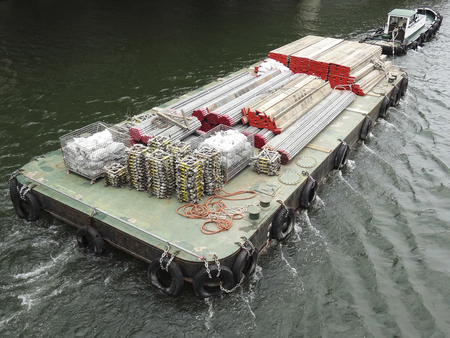barge: Barge carrying building materials