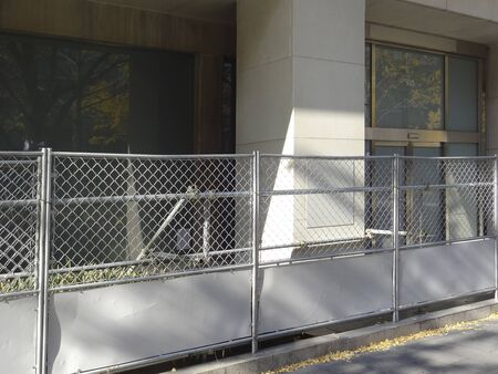 wire mesh: Building demolition work plan, which is surrounded by wire mesh