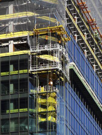 高層ビルの建設中の建物 写真素材