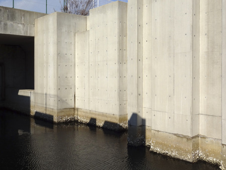 sidewall: Concrete side walls of the canal