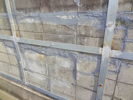 reinforcing: Reinforcing iron plate of cracked concrete block walls Stock Photo