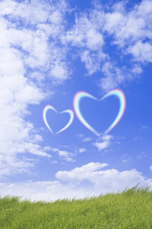 feel affection: Blue sky and grassland and the Heart of the rainbow Stock Photo