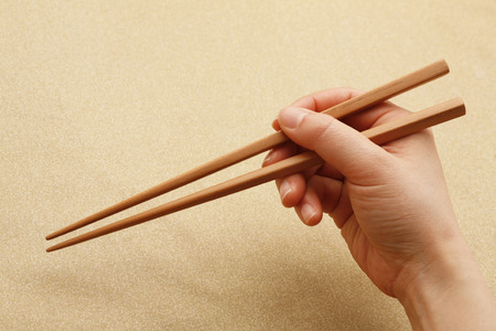 chopsticks: Chopsticks and hand