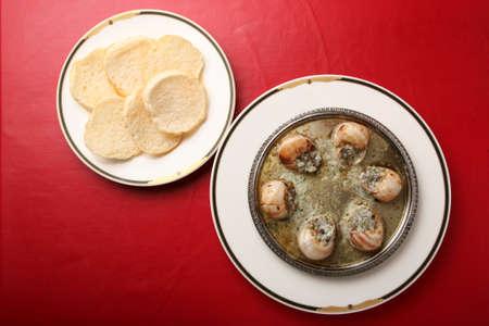 Escargot and Melba toast Stock Photo