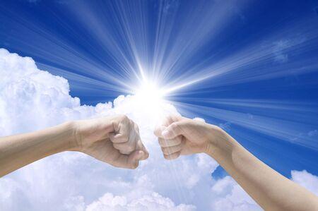 shine: Fist bump with sun shine Stock Photo