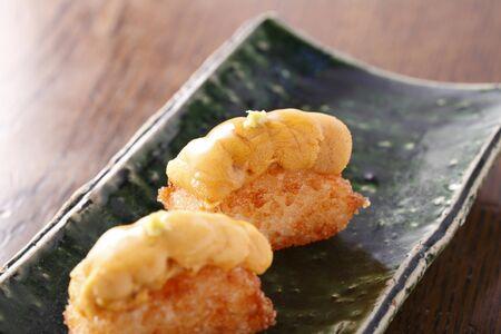 urchin: Grilled sea urchin nigiri sushi Stock Photo