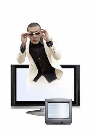 big screen tv: Men coming out from LCD TV Stock Photo